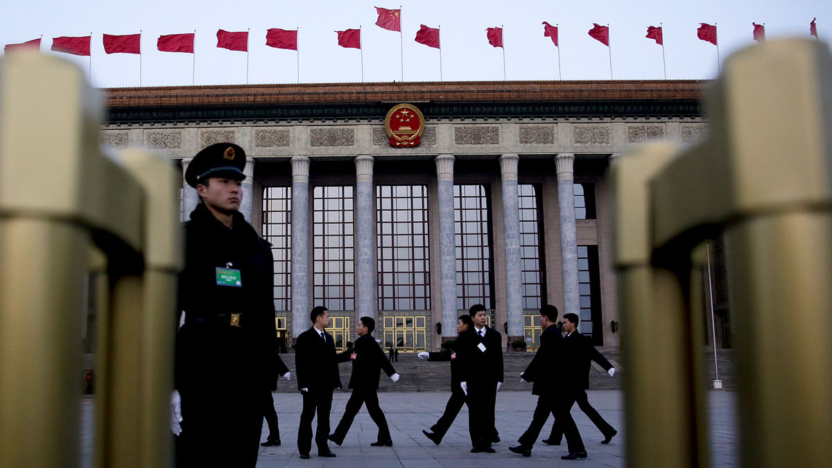 Chinese soldiers dressed as ushers march to their position in front of the Great Hall of the People before the opening session of the annual National People's Congress in Beijing, 5 March 2016. (Photo: AP)