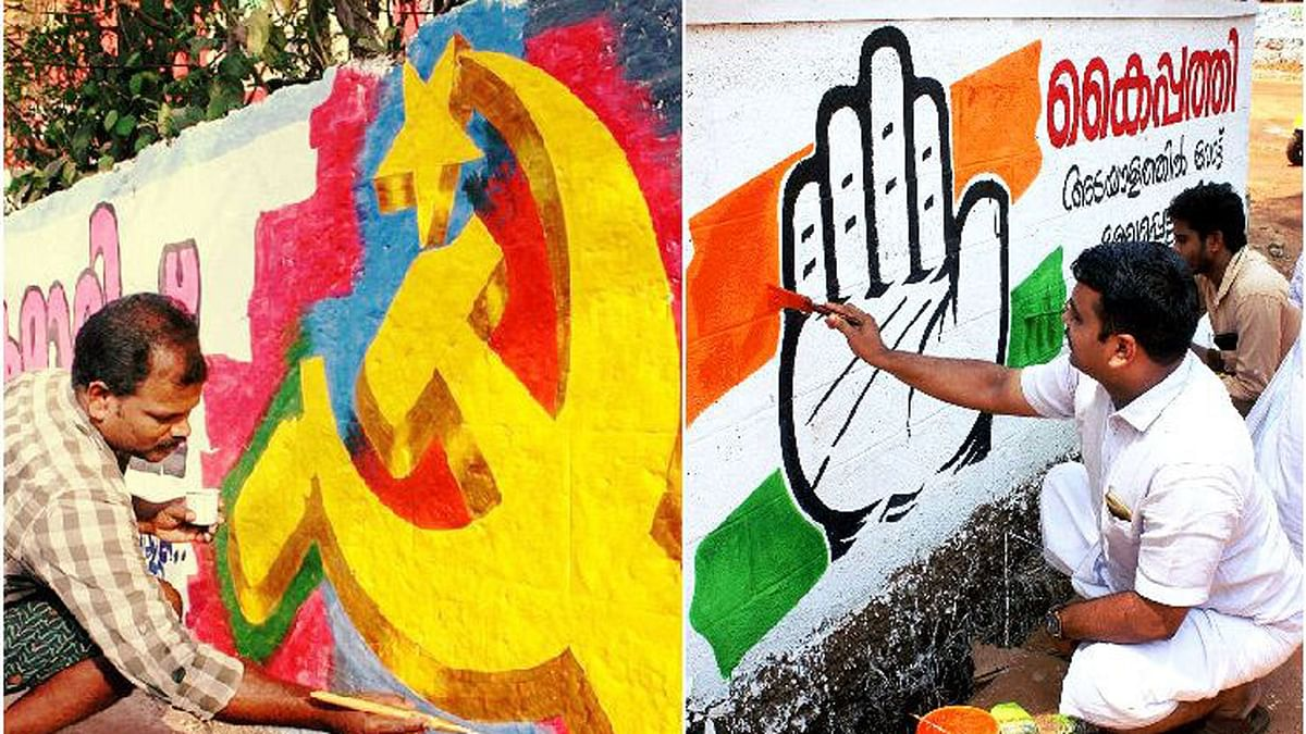 Symbols of CPI and COngress being painted on walls. (Photo: The News Minute)