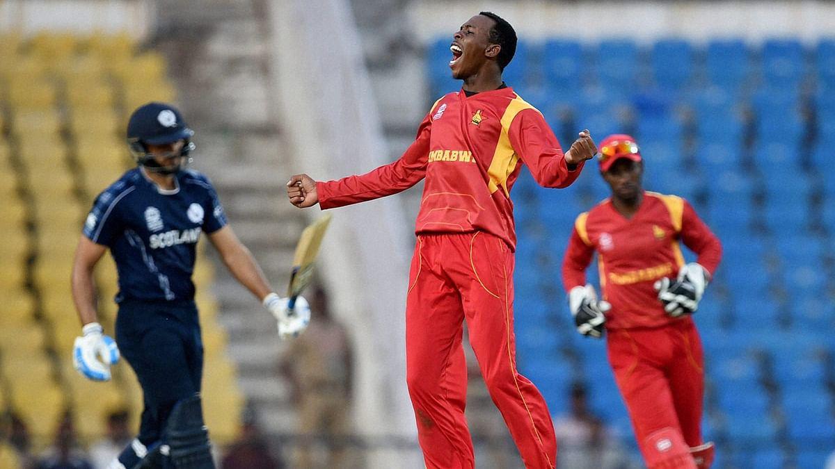 Zimbabwe's Wellington Masakadza (center) celebrates a wicket in their match against Scotland in the ICC World Twenty20 2016 tournament in Nagpur. (Photo: AP)