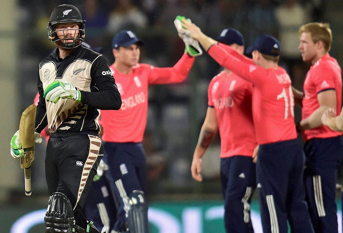 New Zealand batsman M Guptill leaves the ground after losing his wicket to David Willey. (Photo: PTI)