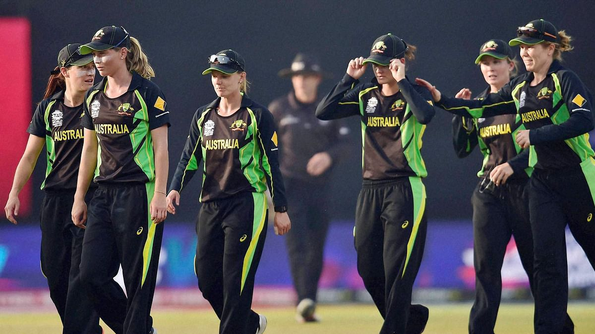 Australian cricketers walk back to the pavilion after beating England by five runs in the first semifinal of ICC Women's World T20 at Feroz Shah Kotla stadium in New Delhi (Photo: PTI)