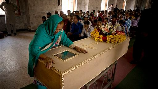 The grandmother of Pakistani Christian boy mourns his death, at a church in Lahore. (Photo: AP/BK Bangash)