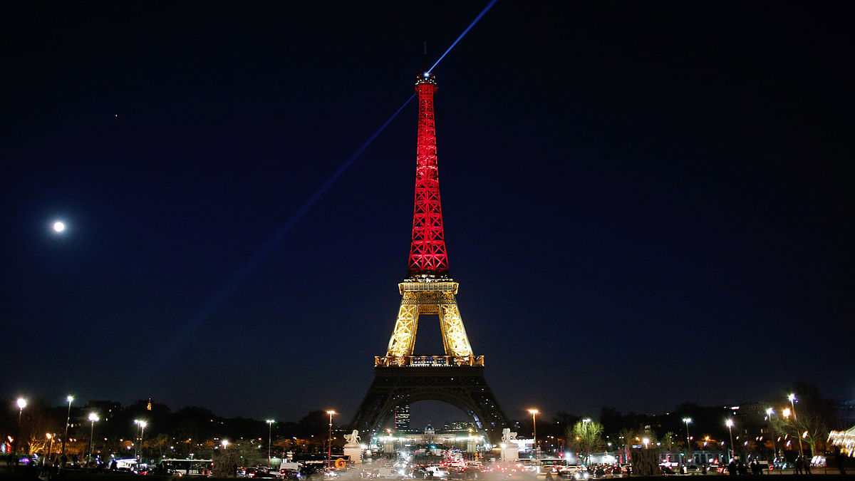 The Eiffel Tower is illuminated with the Belgium national colors black, yellow and red in honor of the victims of the Brussels terror attack, in Paris,  March 22, 2016. (Photo: AP)