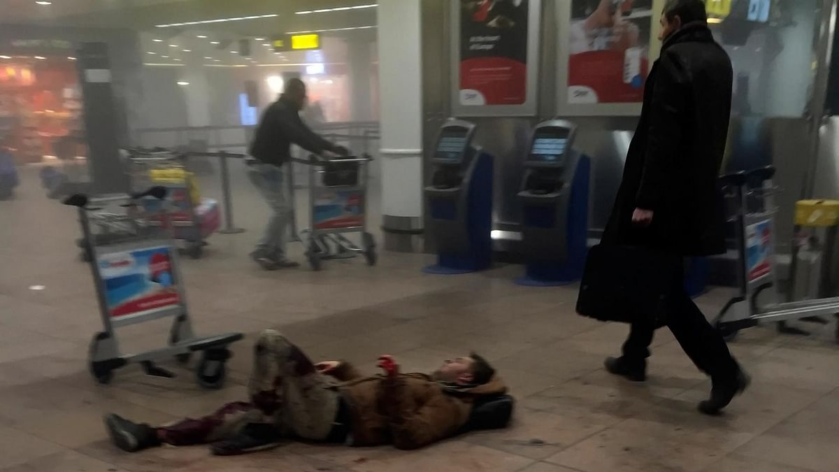 An injured man inside Brussels airport after the attack. (Photo: AP)