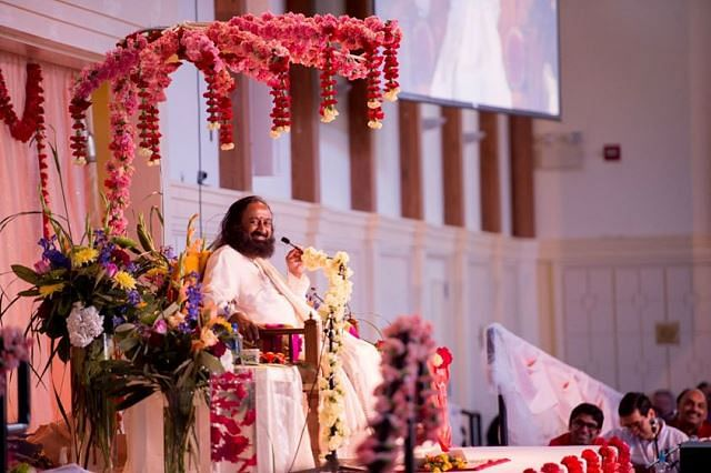 Founder of Art of Living, Sri Sri Ravishankar, at the Art of Living Retreat Centre. (Photo Courtesy: Art of Living Foundation Facebook page via <i>The News Minute</i>)