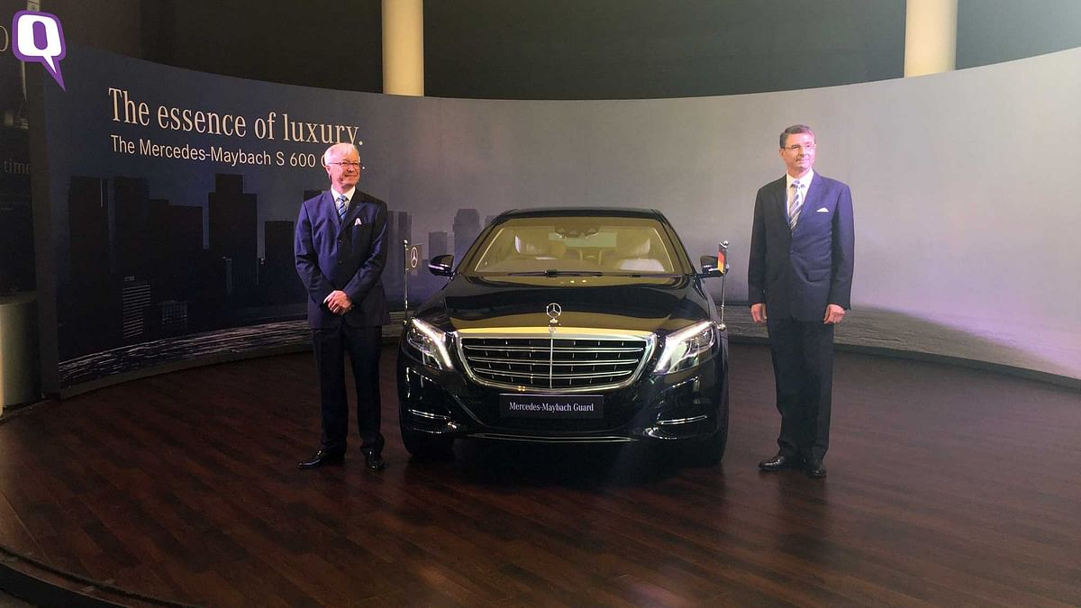 German Ambassador to India, Dr Martin Ney (Right) and Roland Folger, Managing Director and CEO, Mercedes-Benz India (Left) with the new Mercedes-Maybach S600 Guard. (Photo: <b>The Quint</b>)