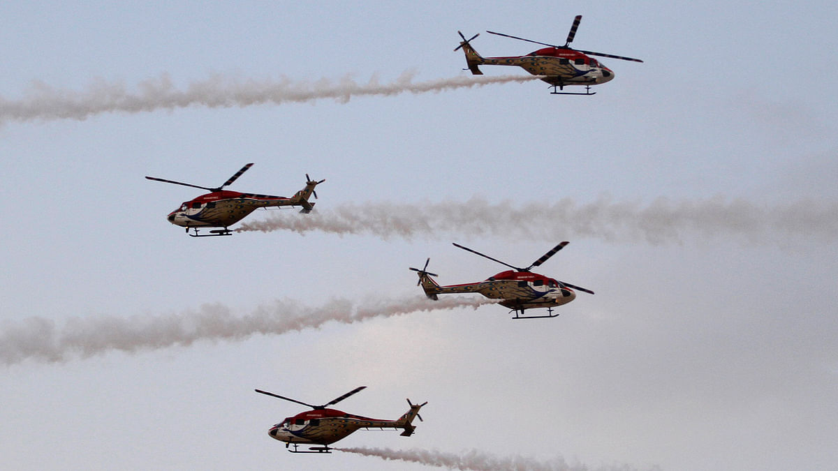 An Indian air force team flies advanced light helicopters for an aerobatic display during exercise 'Iron Fist' in Pokhran. (Photo: AP)