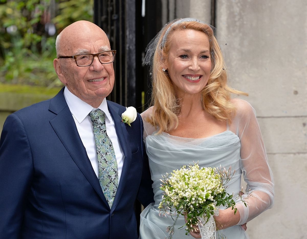 Media proprietor Rupert Murdoch and Jerry Hall pose outside St Bride's Church in London for a ceremony to celebrate their wedding, on 5 March 2016.