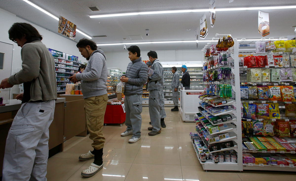 Workers stand in a checkout line at a convenience store in Minamisoma, Fukushima Prefecture, northeastern Japan. (Photo: AP)