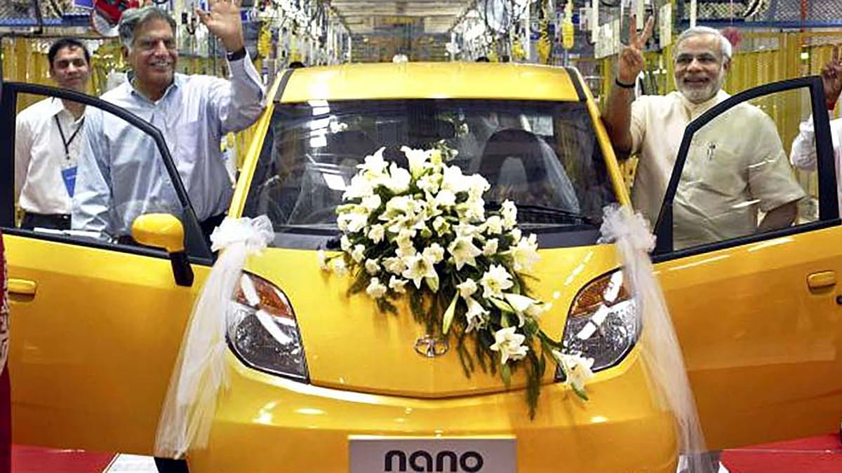 Tata Group Chairman Ratan Tata, (left) and the then Gujarat Chief Minister Narendra Modi rolling out the first Tata Nano in Sanand, near Ahmedabad. (Photo: AP)