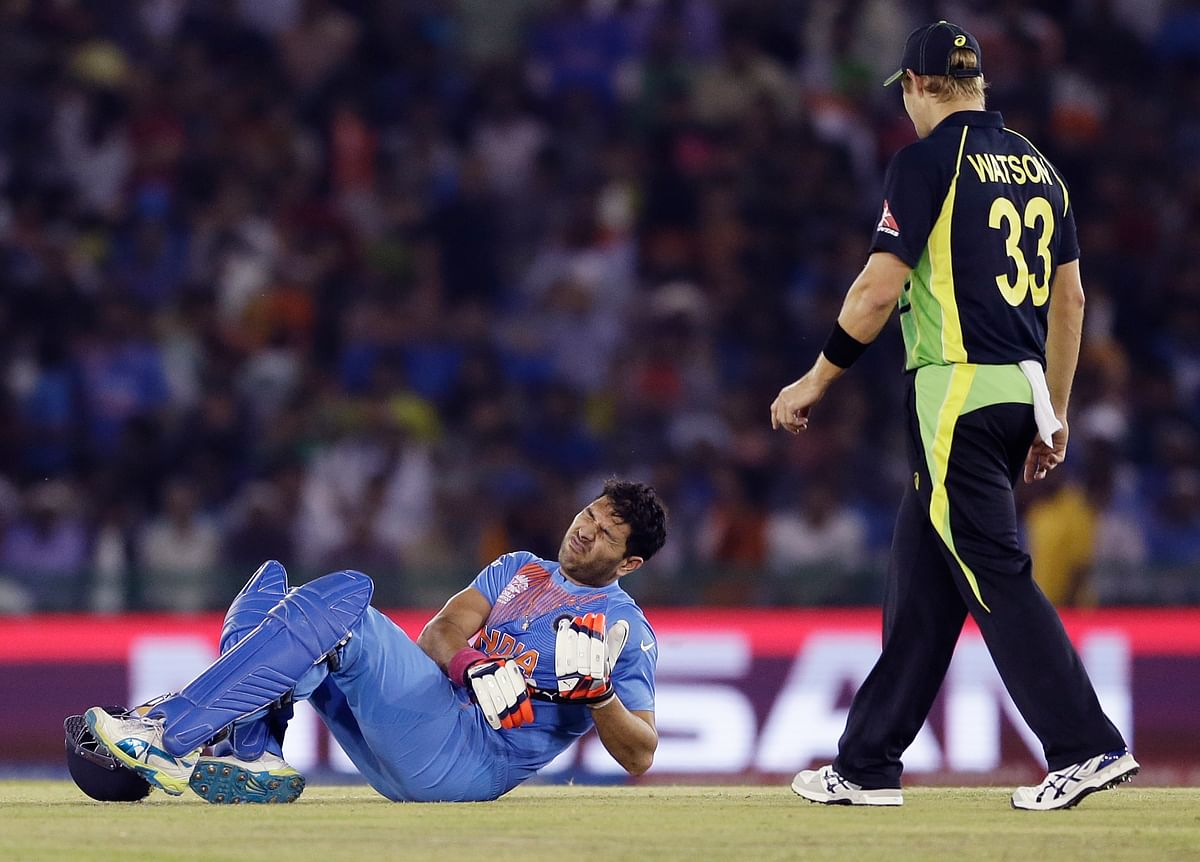 Yuvraj Singh after battling his injury during the match against Australia (Picture: AP)