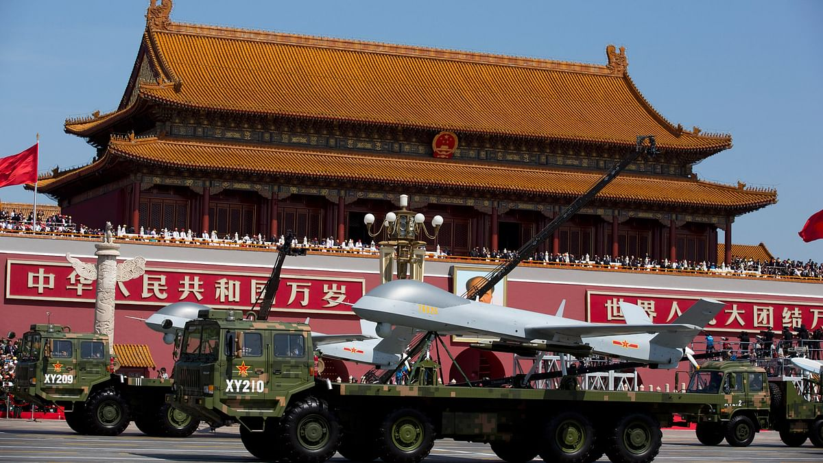 Military vehicles carrying Wing Loong, a Chinese made medium-altitude long-endurance unmanned aerial vehicle, drive past Tiananmen Gate during a military parade  in Beijing, 3 September 2015. (Photo: AP)
