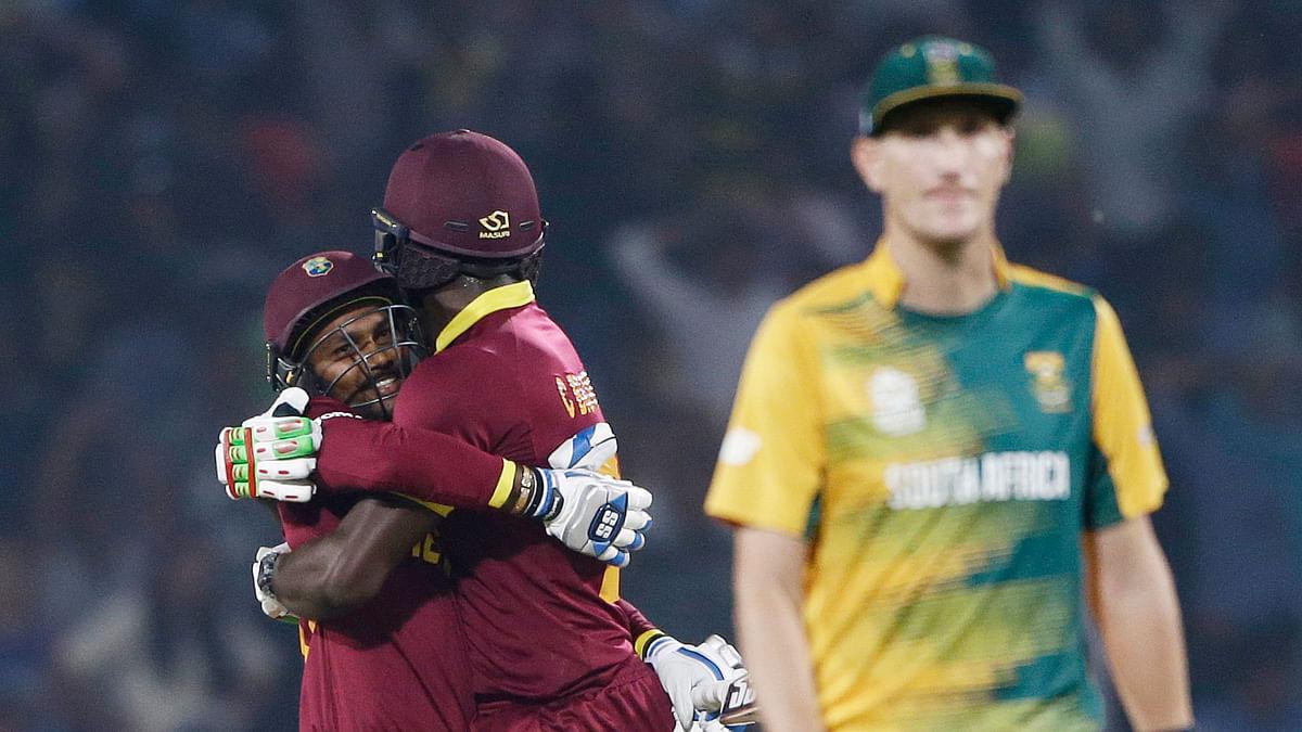 Denesh Ramdin, left, and Carlos Brathwaite celebrate after defeating South Africa in their ICC World Twenty20 2016 cricket match in Nagpur (Photo: AP)