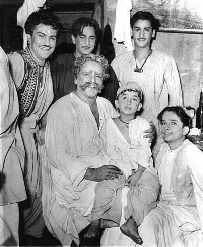 The Kapoors: Raj and Shammi Kapoor (standing) Prithviraj Kapoor sitting with a young Randhir Kapoor on his lap and Shashi Kapoor sitting next to him.