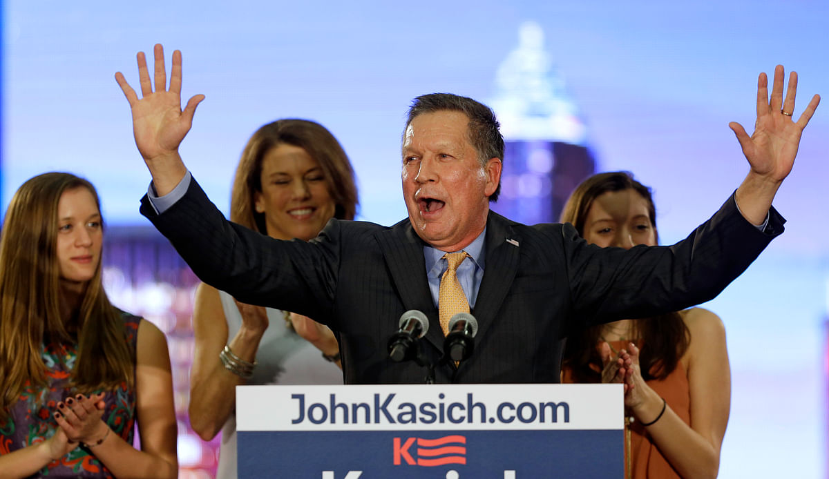 Republican presidential candidate Ohio Gov. John Kasich speaks at his presidential primary election night rally in Berea, Ohio, on Tuesday, 15 March 2016. His wife, Karen, and daughters, Emma, left, and Reese listen. (Photo: AP)<a></a>