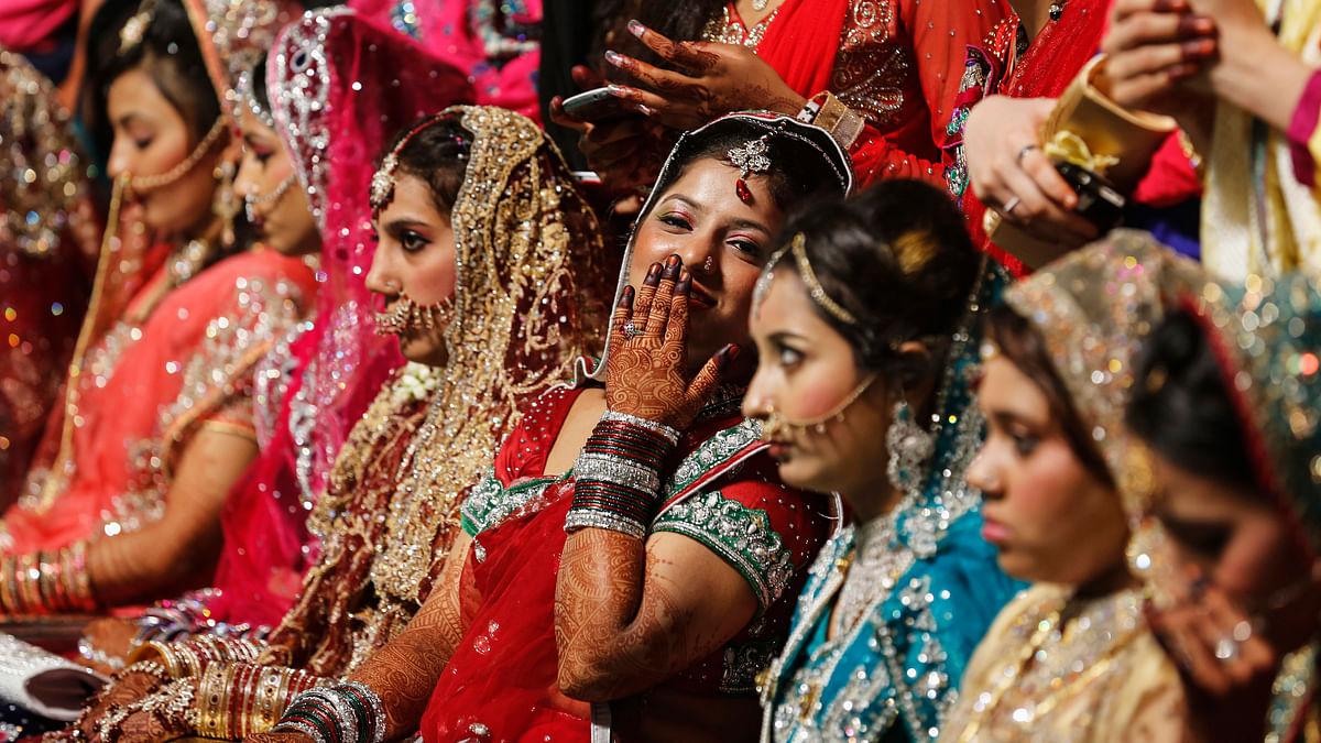 Brides at a mass wedding in Mumbai. (Photo: Reuters)