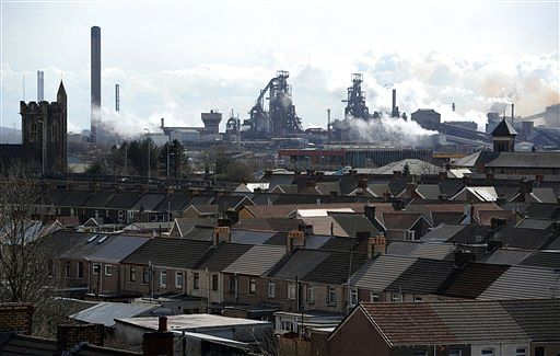 The Tata steel plant dominates the skyline over the roof tops of Port Talbot, Wales (Photo: AP)