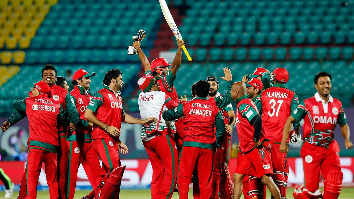Oman's players celebrate after winning the ICC World Twenty20 match against Ireland at the Himachal Pradesh Cricket Association (HPCA) stadium in Dharamsala. (Photo: AP)