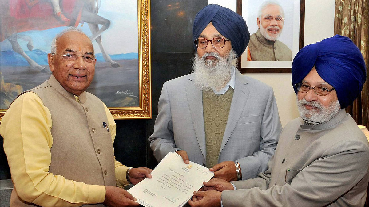 Punjab and Haryana Governor receives the thank you copy of the resolution passed by the Punjab assembly from Speaker Charanjit Singh Atwal and Punjab CM Parkash Singh Badal (centre) in Chandigarh, March 16, 2016. (Photo: PTI)