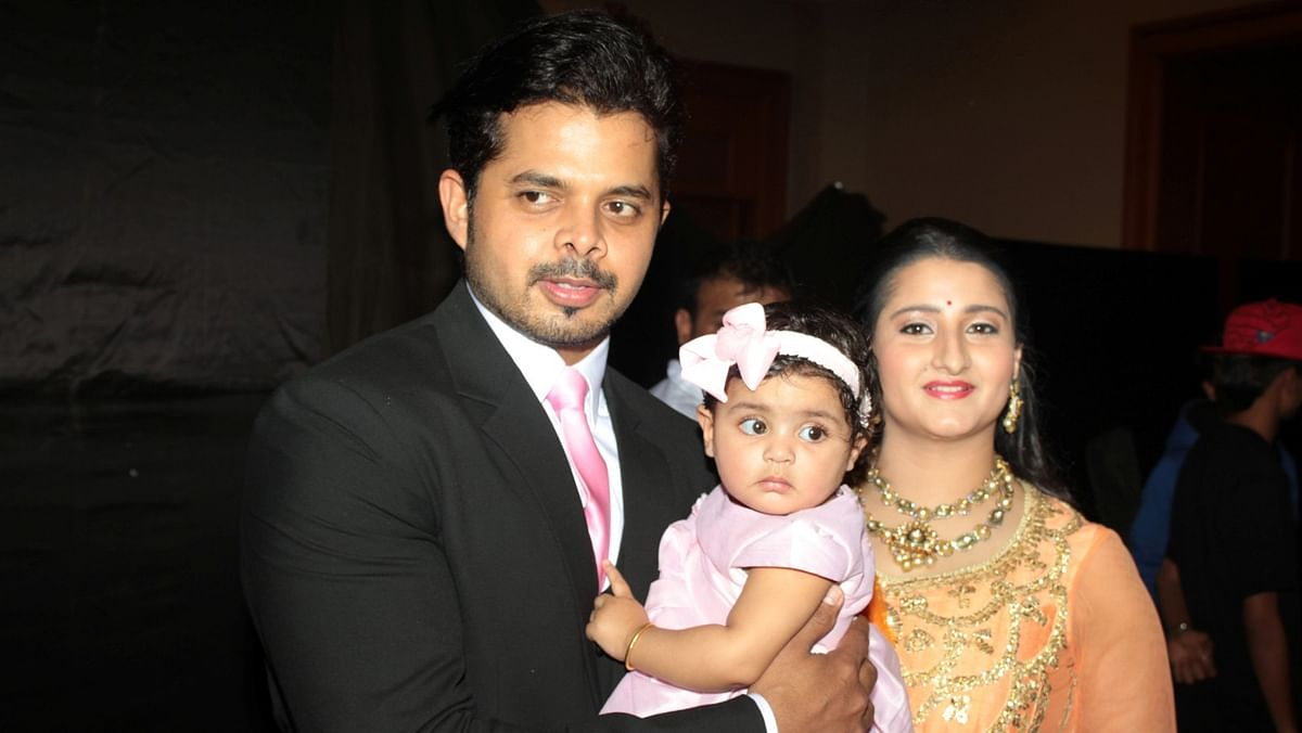 File picture of S Sreensath with his wife and daughter.