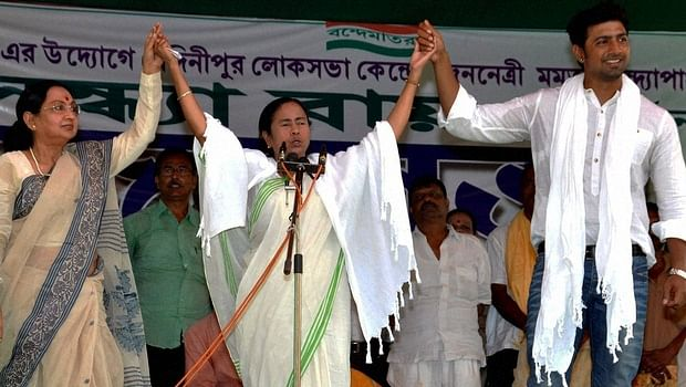 Mamata Banerjee (middle) with the actors Dev and Sandhya Roy. (Photo: PTI)