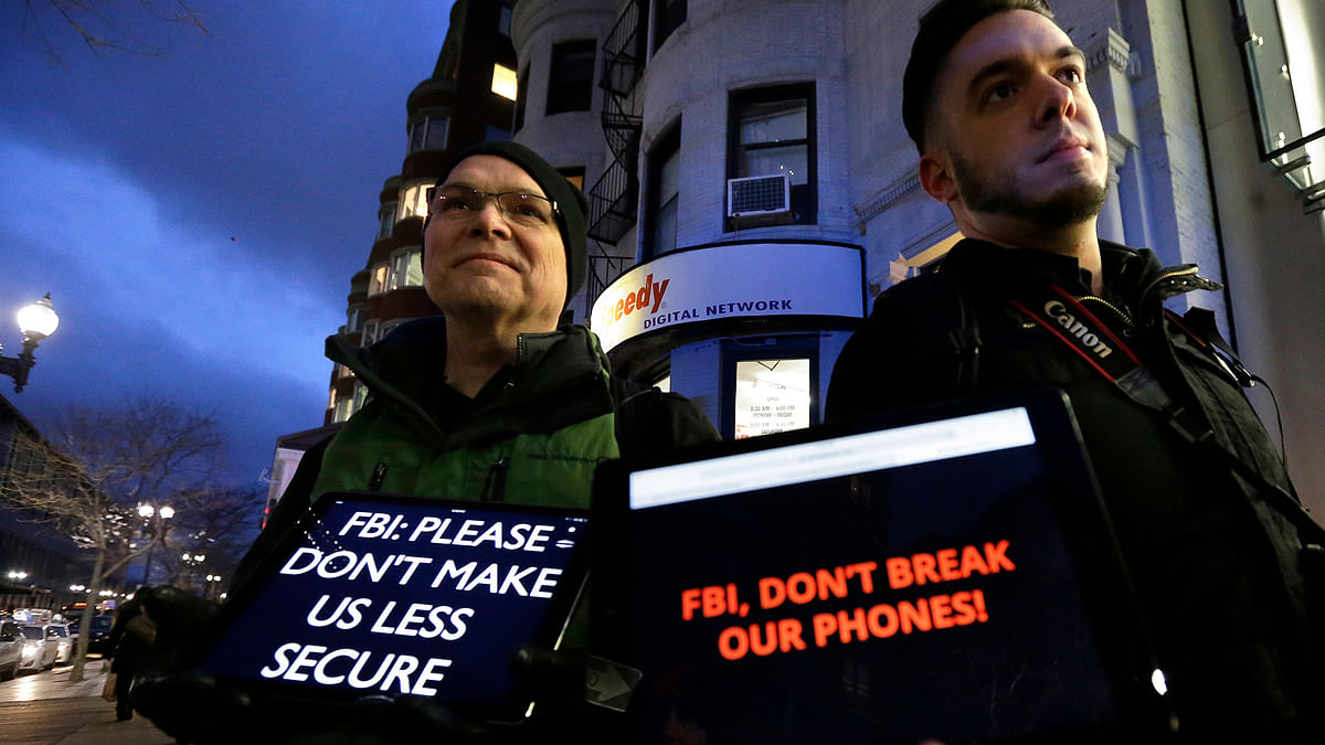 People displaying messages asking for privacy from law enforcement agencies. (Photo: AP)
