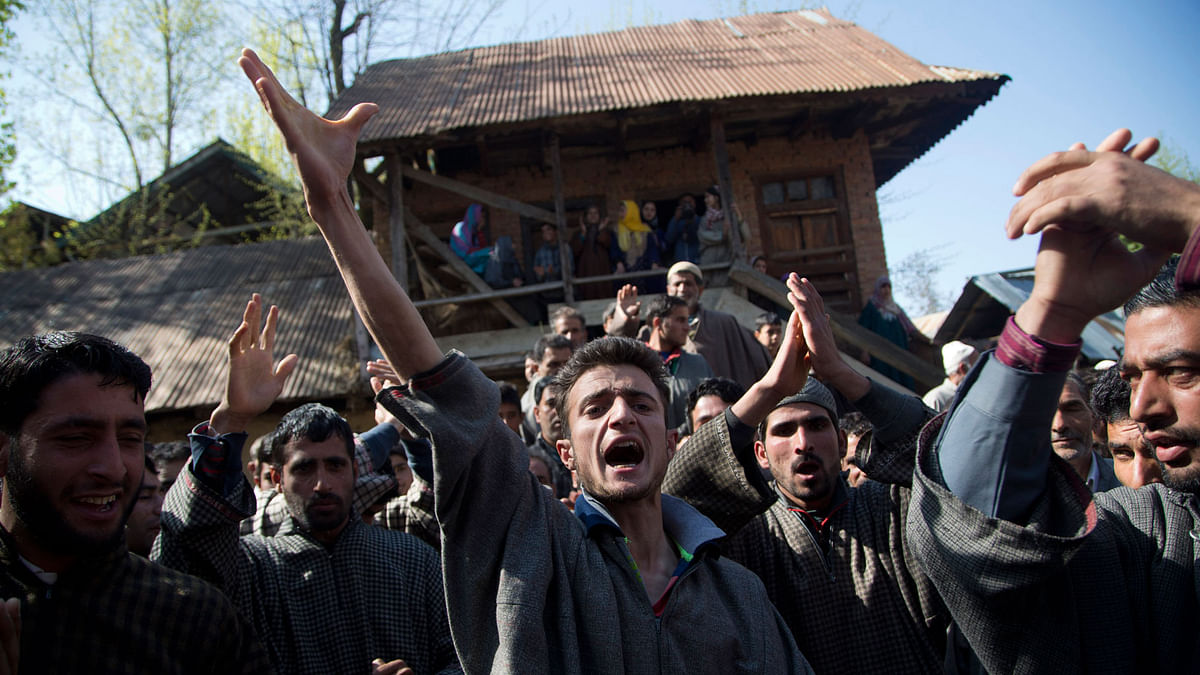 Kashmiri Muslim villagers shout slogans against India during the funeral procession of Raja Begum, a 70-year-old woman, who was hit by gunfire Tuesday, in Langate some 75 km  north of Srinagar, Kashmir, Wednesday, April 13, 2016. (Photo: AP)
