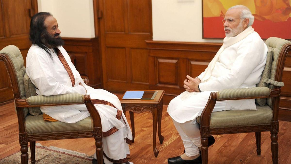 Sri Sri Ravi Shankar with Prime Minister Narendra Modi in New Delhi on 29 December 2015. (Photo: IANS)
