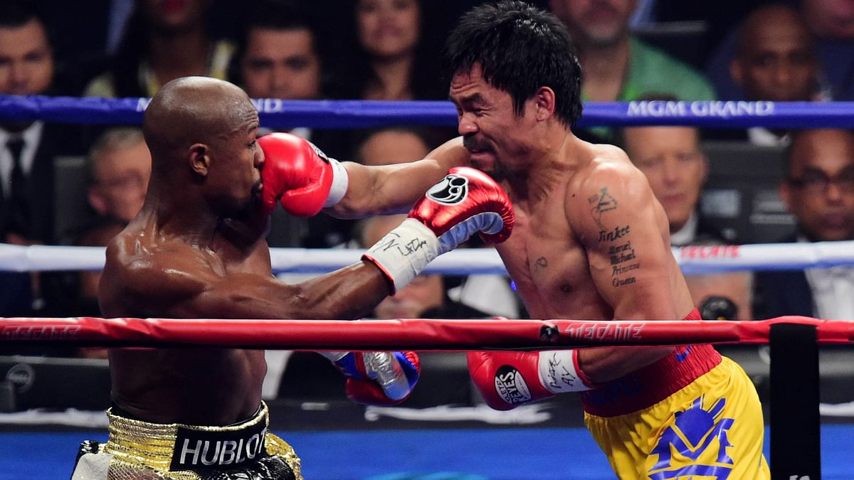 Floyd Mayweather and Manny Pacquiao box during their world welterweight championship bout in May, 2015. (Photo: Reuters)