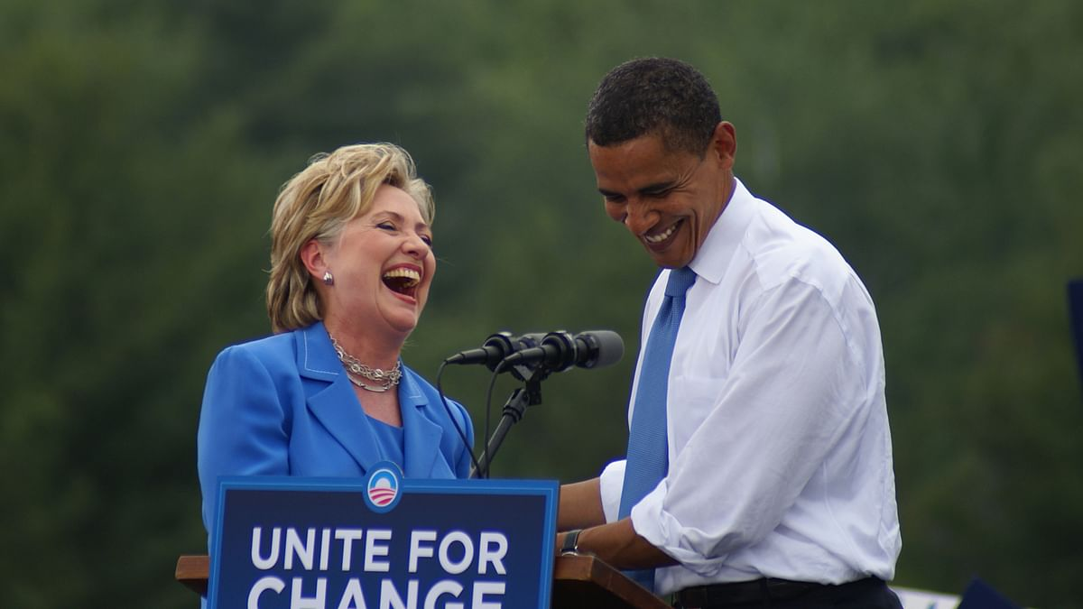"""A file photo of Hillary Clinton and President Barack Obama sharing a laugh. (Photo: <a href=""""https://www.flickr.com/photos/marcn/"""">Marc Nozell</a>)"""