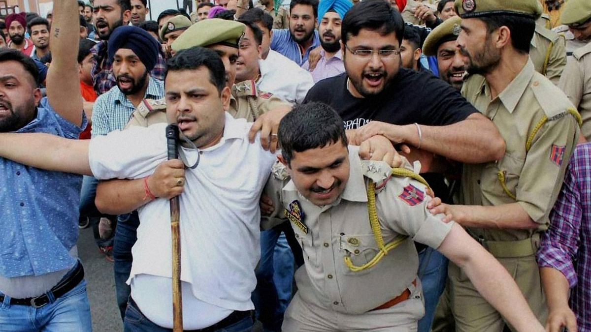 Youth Congress workers protest in front of Jammu and Kashmir Deputy Chief Minister Nirmal Singh's residence over the NIT Srinagar issue. (Photo: PTI)