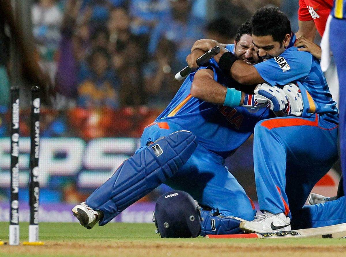 Yuvraj Singh (L) and Virat Kohli celebrate after defeating Sri Lanka in the 2011 ICC World Cup final. (Photo: Reuters)