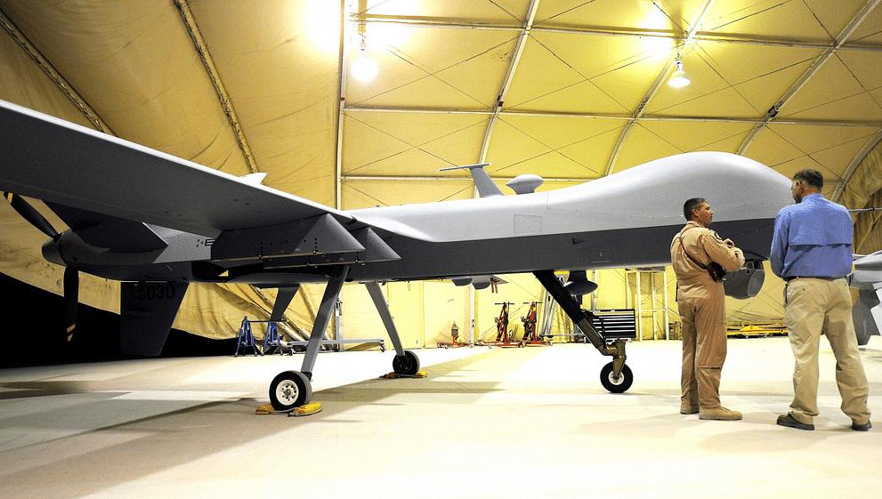 "US Air Force Lt Col Morgan Curry briefs Deputy Secretary of Defense William J Lynn III on the capabilities of a Predator unmanned aerial vehicle at Kandahar Air Field, Afghanistan, Sept. 10, 2009. (Photo Courtesy: <a href=""https://www.flickr.com/photos/39955793@N07/3910234448/"">defense.gov</a>)"