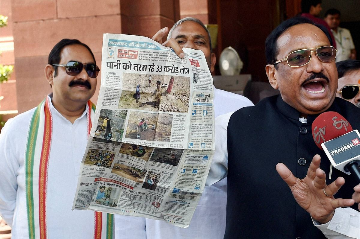 Congress MP Kantilal Bhuria showing newspaper to media regarding the drought situation in the country during the first day of the new session of Parliament (Photo: PTI)