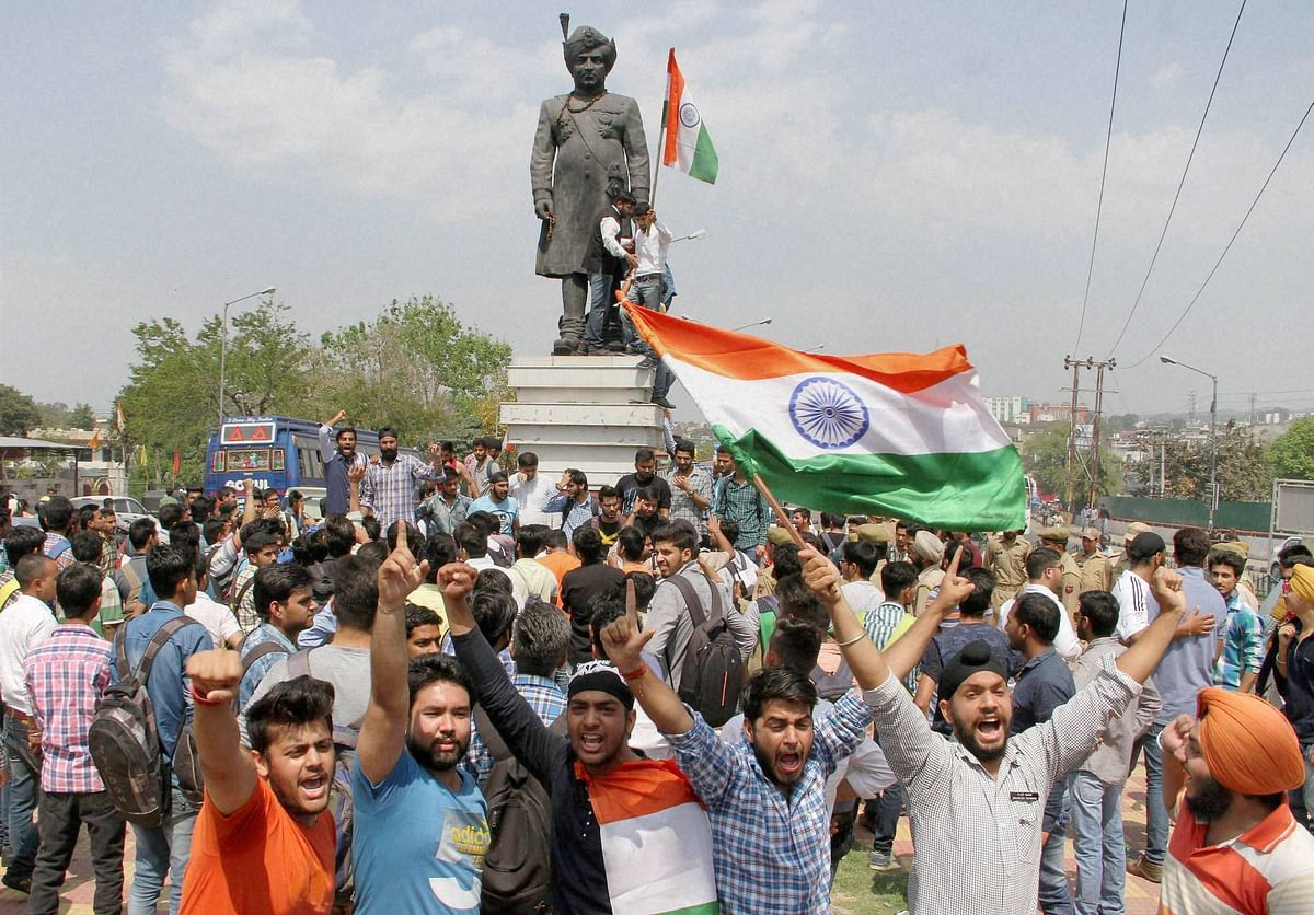Non-Kashmiri students raising the tricolour. (Photo: PTI)