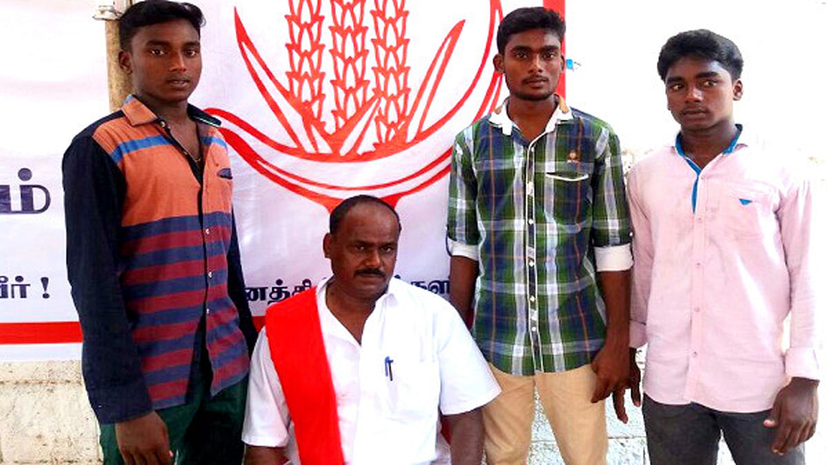 CPI member Mohan with his three sons, Marxism, Leninism and Socialism. (Photo Courtesy: <i>The News Minute</i>)