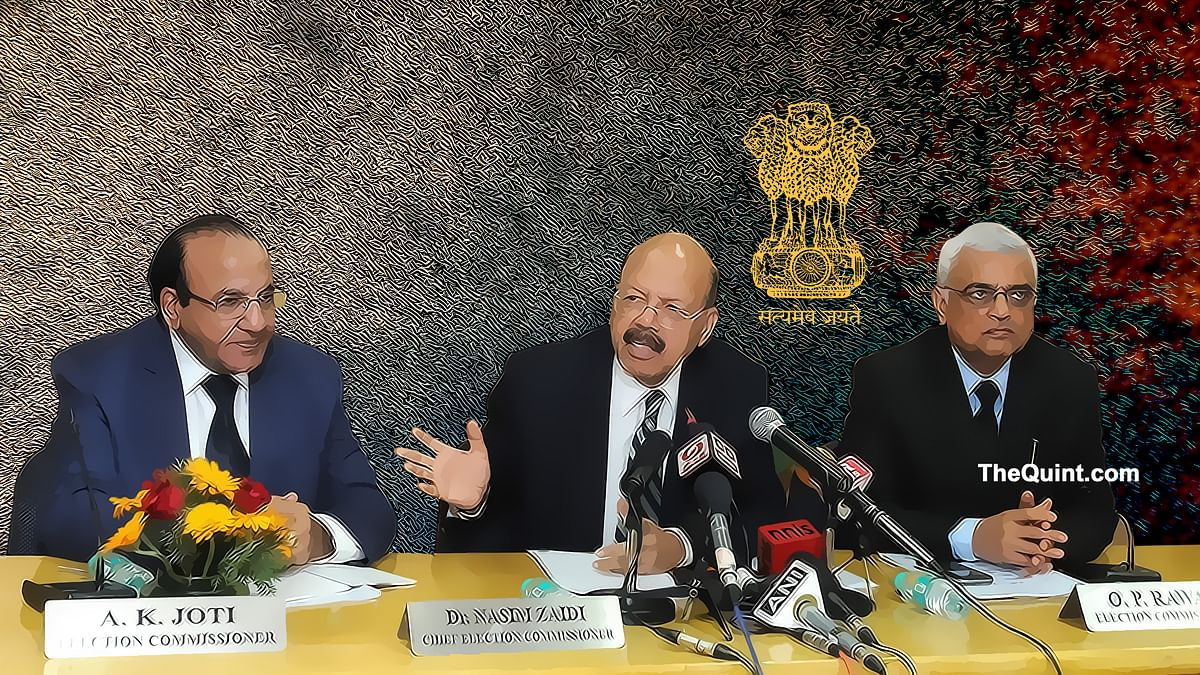 Chief Election Commissioner, Dr. Nasim Zaidi addresses a press conference, in New Delhi on 4 March 4, 2016. Also seen Election Commissioners A.K. Joti and O.P. Rawat.  (Photo: IANS/ Altered by <b>The Quint</b>)