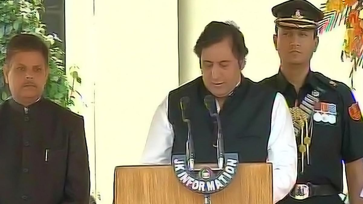 File photo of Sajjad Lone taking oath in Chief Minister Mehbooba Mufti's cabinet. (Photo Courtesy: ANI)