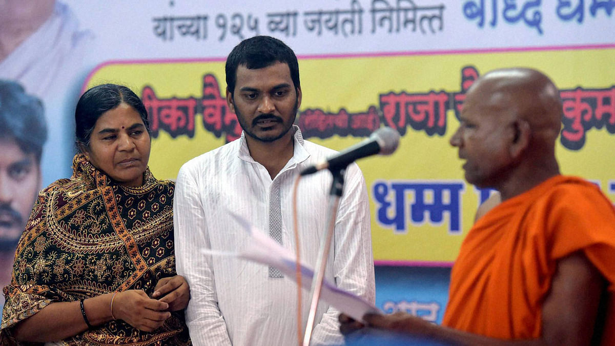 Rohith Vemula's mother and brother embrace Buddhism on Thursday in Dadar, Mumbai. (Photo: PTI)