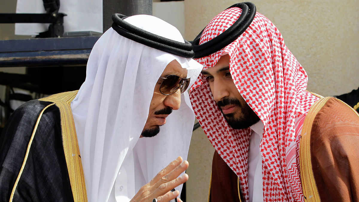 In this 14 May  2012 file photo, then Crown Prince Salman bin Abdul-Aziz Al Saud, left, speaks with his son Prince Mohammed bin Salman. (Photo: AP)