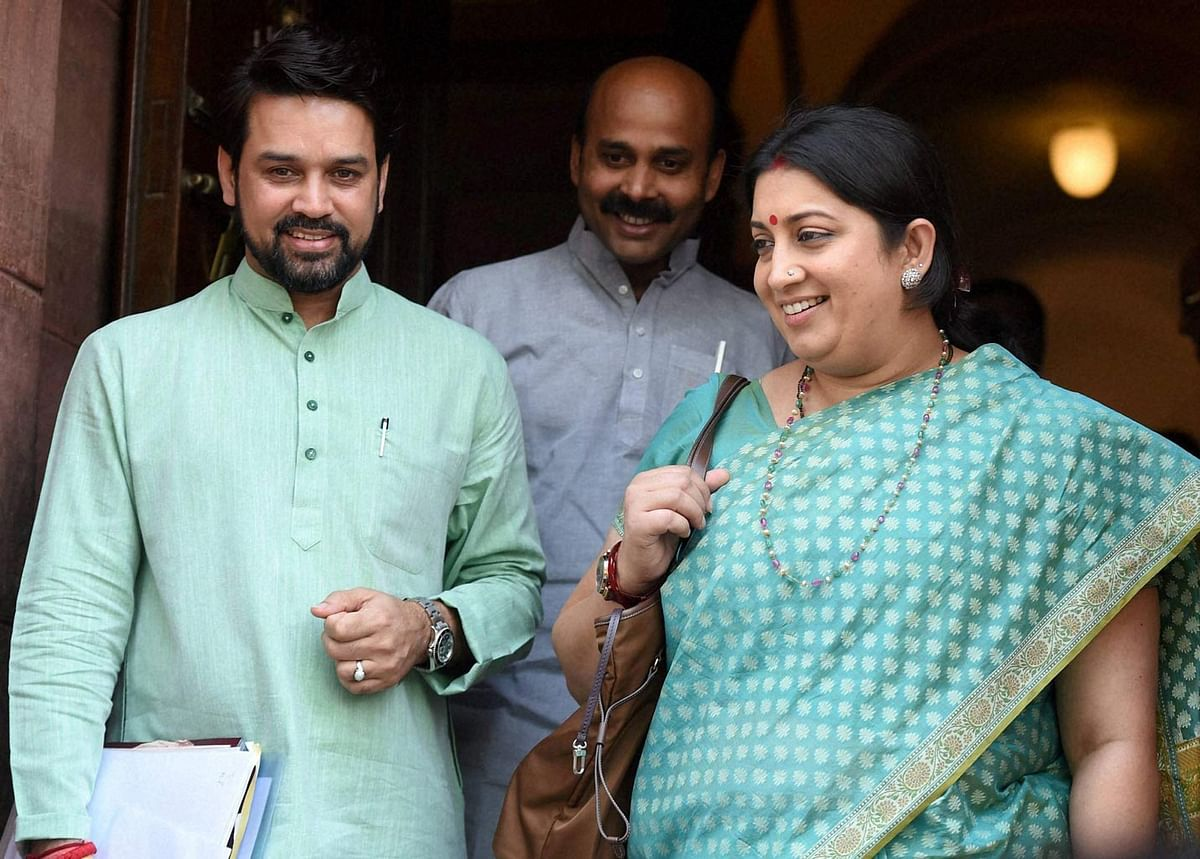 HRD Minister Smriti Irani and BJP MP Anurag Thakur during the Parliament Session in New Delhi on Wednesday, 27 April 2016. (Photo: PTI)