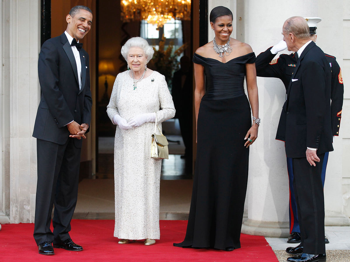 In this 25 May  2011, file photo, President Barack Obama and first lady Michelle Obama welcome Britain's Queen Elizabeth II and Prince Philip for a reciprocal dinner at Winfield House in London. (Photo: AP)