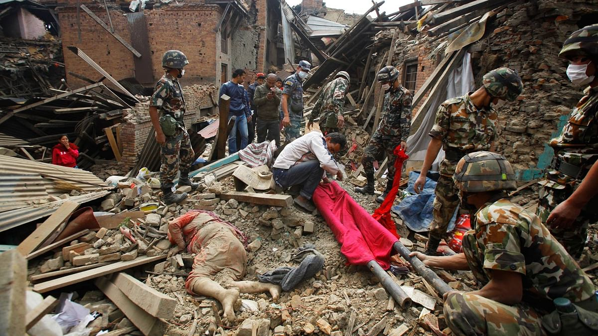 In this 26 April  2015 file photo, the dead body of a woman is seen after rescue workers recovered it from debris following earthquake in Bhaktapur near Kathmandu, Nepal.