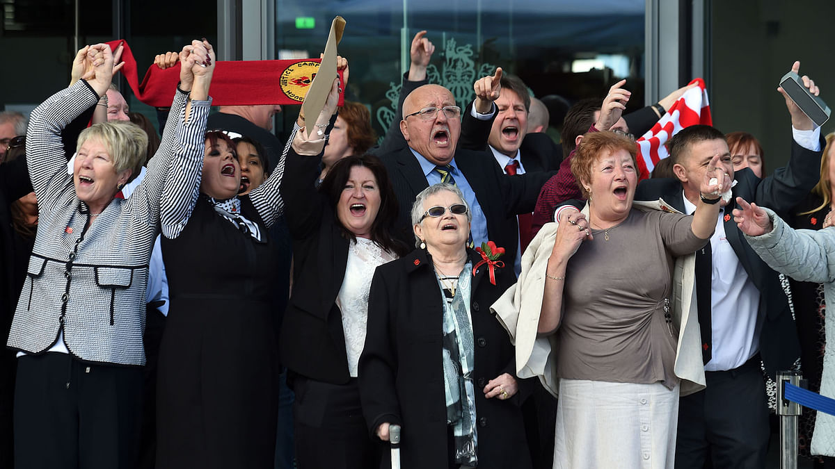 Jubilant relatives of those who died in the Hillsborough disaster after the verdict. (Photo: AP)