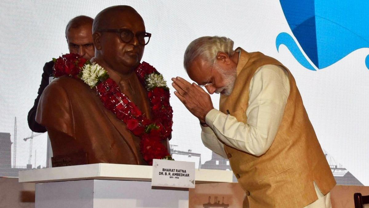"PM Modi bows down to the statue of Dr Ambedkar. (Photo Courtesy: Twitter/<a href=""https://twitter.com/narendramodi"">@narendramodi</a>)"