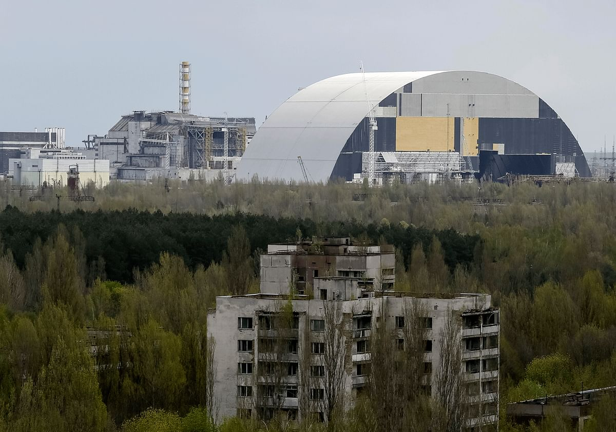 The destroyed Reactor No 4 and the new containment shield being built can be seen at the horizon from the dangerously close township of Pripyat. Due to this proximity, people inhaled up to 500 roentgen an hour following the explosion – a lethal dose of radiation for humans. (Photo: Reuters)