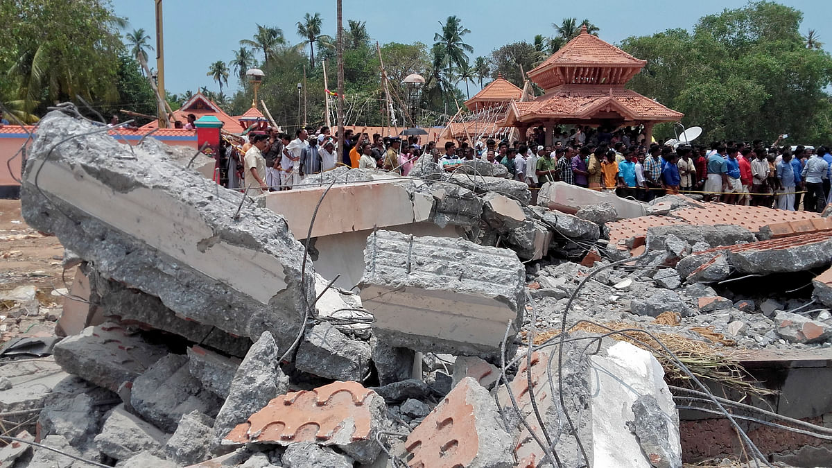 A view of a collapsed building after a massive fire broke out during a fireworks display at the Puttingal temple complex in Paravur village, north of Thiruvananthapuram, Kerala, Sunday, 10 April 2016. (Photo: AP)