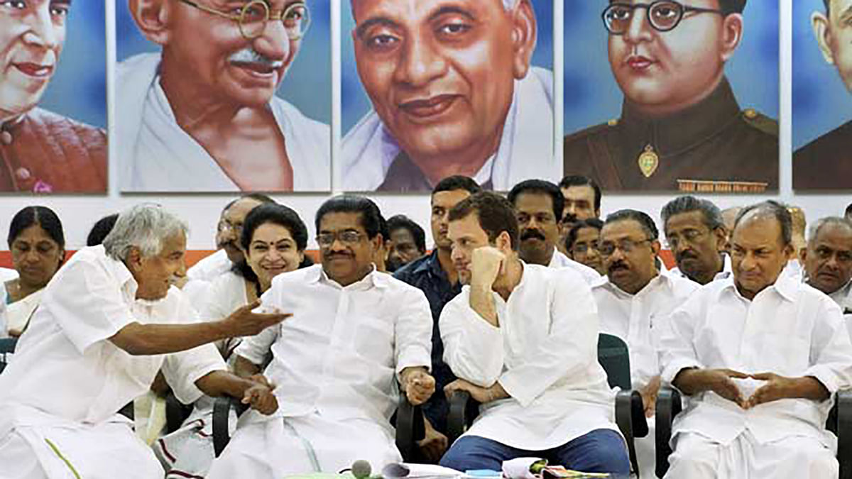Rahul Gandhi with Kerala Chief Minister Oommen Chandy (L),party MP AK Anthony and others.