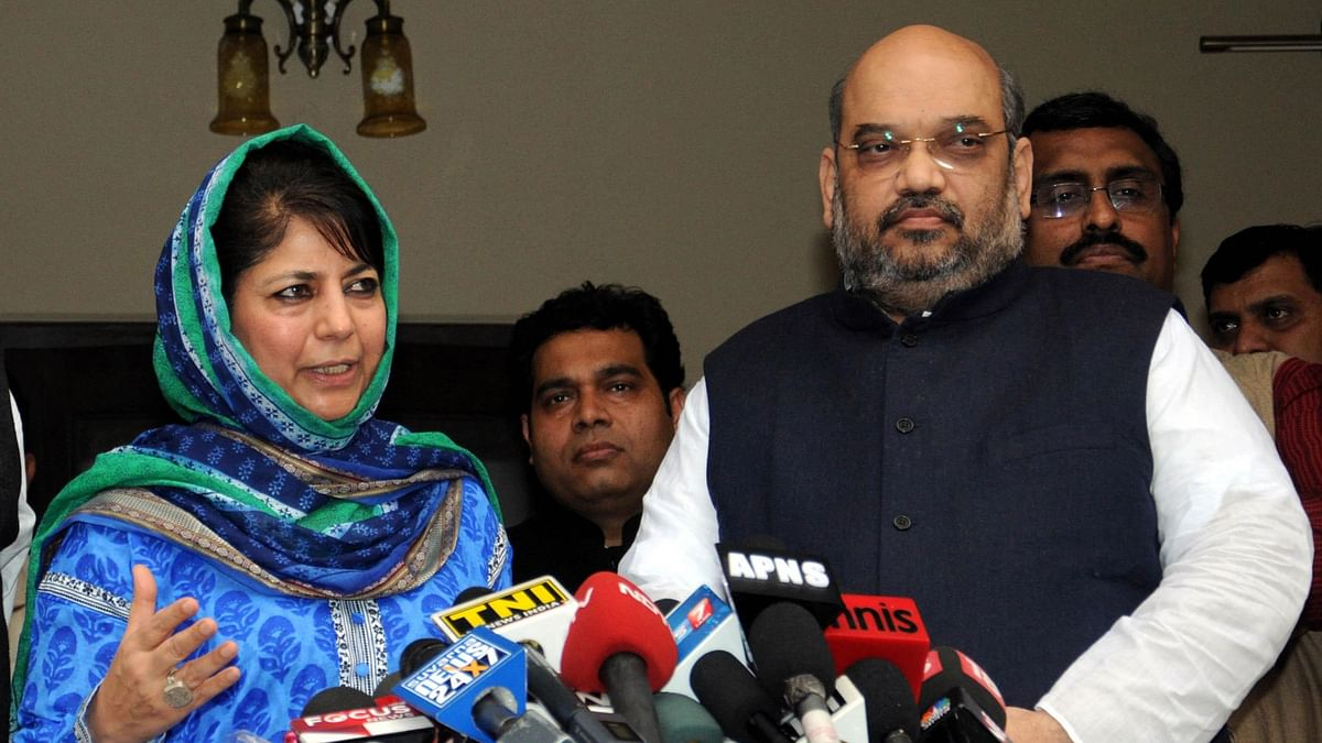 PDP leader Mehbooba Mufti and BJP chief Amit Shah talk to press regarding government formation in Jammu and Kashmir, in New Delhi, on 24 February 2015. (Photo: IANS)