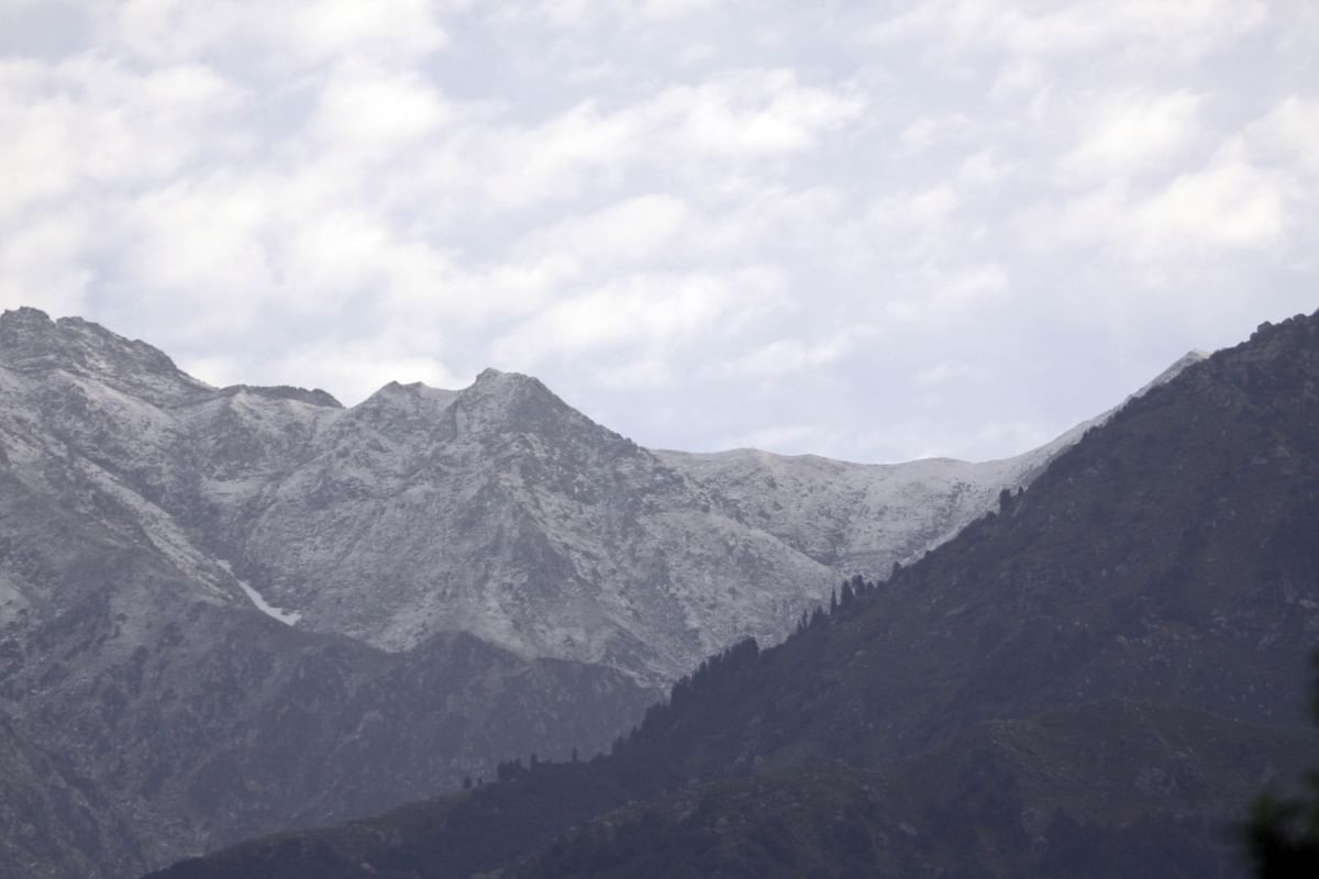Palampur: A view of snow-capped Dhauladhar range as seen from Palampur. (Photo: IANS)
